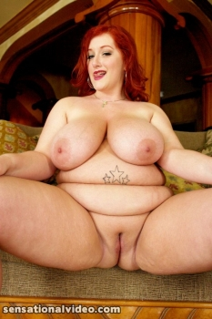 redhead bbw with juicy jugs, posing camera