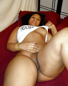 Shaved ebony bbw flashes her cunt