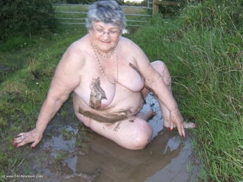 Fat pig grandma in the mud